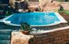 Beispiel für ein Power-S Becken mit römischer Treppe von Future Pool